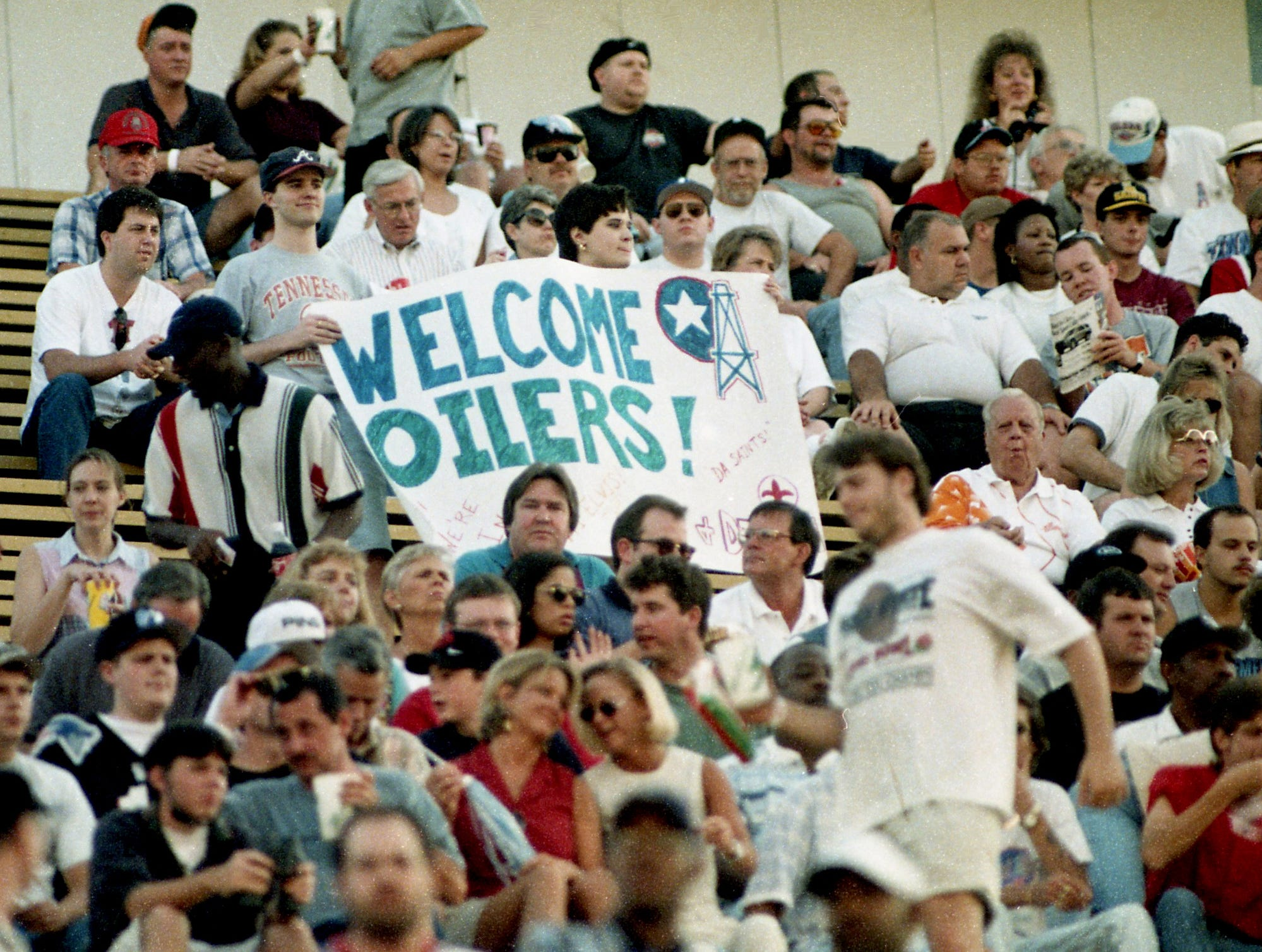 Tennessee Oilers fans welcome their team to Memphis' Liberty Bowl for their very first game in their new state and their temporary home Aug. 2, 1997. The Oilers face the New Orleans Saints in the pre-season game.