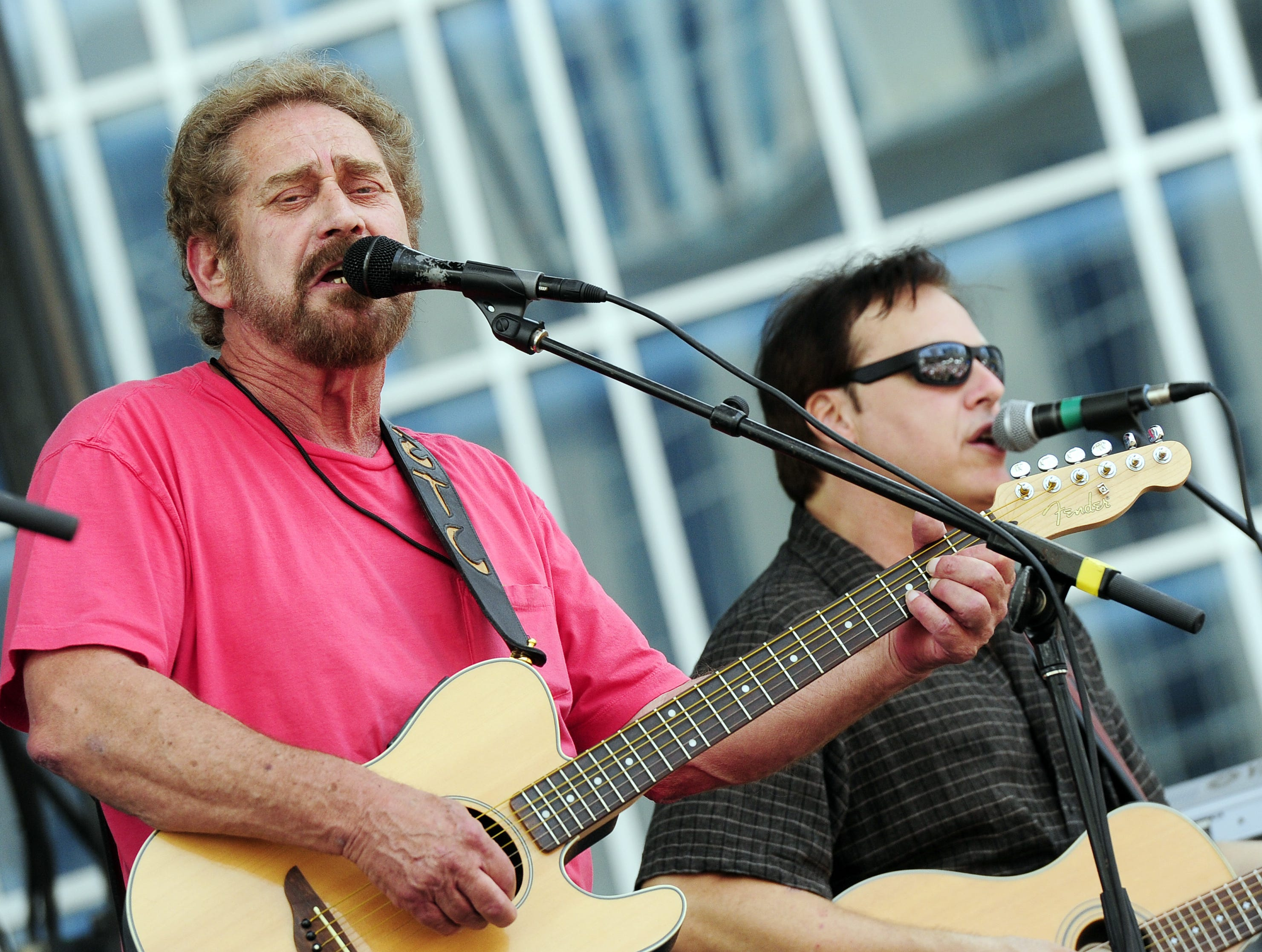 Earl Thomas Conley, left, performs during the CMA Music Festival in downtown Nashville on June 10, 2011.