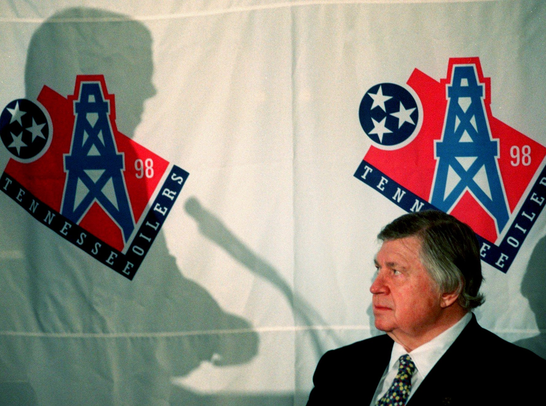 Tennessee Oilers owner Bud Adams, right, listens to Mayor Phil Bredesen as he discusses the change of the Oilers' nickname in the 1999 season during a press conference July 29, 1998.