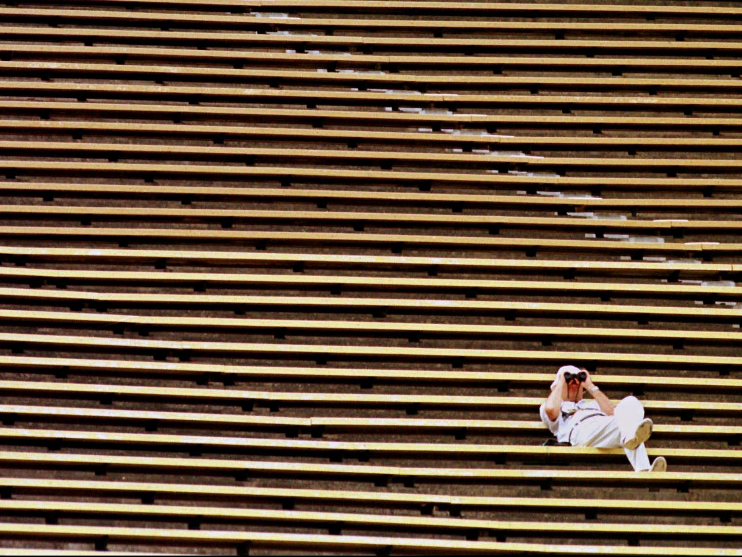A lone fan watches the Baltimore Ravens defeat the Tennessee Oilers 36-10 from his choice of seats at Liberty Bowl Stadium in Memphis Sept. 21, 1997. A crowd of only 17,737 showed up for the game. The stadium capacity is 62,420.