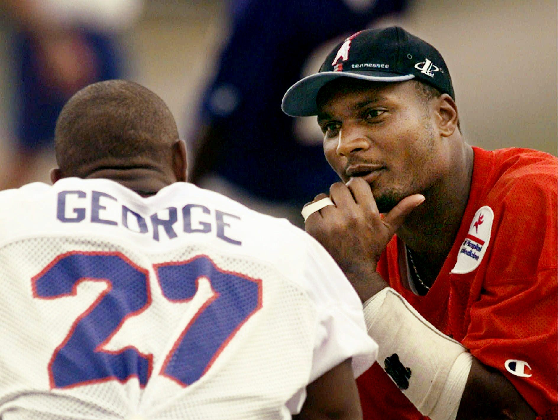 Tennessee Oilers quarterback Steve McNair, right, talks with running back Eddie George during practice Aug. 12, 1998 in Nashville. The Oilers hope their offense, led by McNair, runs as smoothly against the Washington Redskins as it did in its first exhibition game against the Atlanta Falcons.