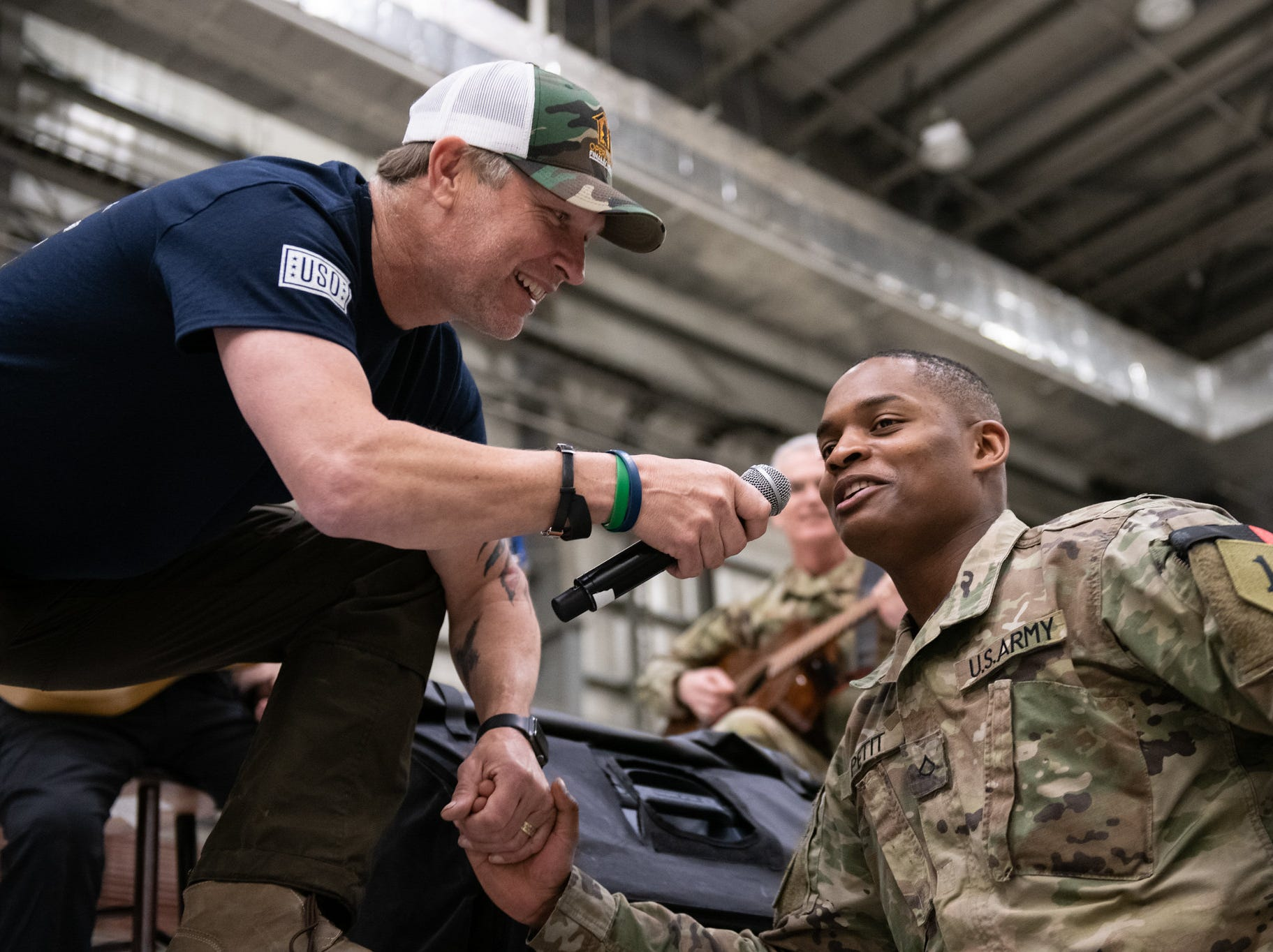 Entertainers and athletes take questions and interact with the audience during a USO Show at Bagram Airfield, Afghanistan; the second stop on the annual Vice Chairman's USO Tour, March 31, 2019. Pictured, left, is country musician and Dickson resident Craig Morgan.