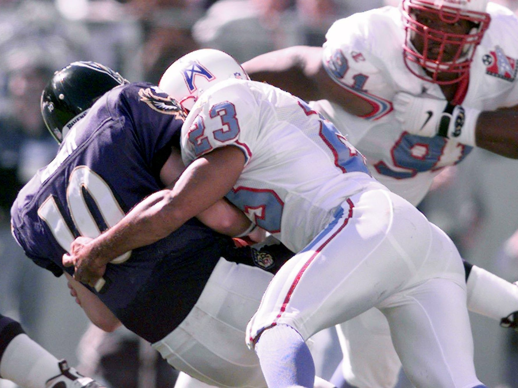 Tennessee Oilers safety Blaine Bishop (23) sacks quarterback Eric Zeier of the Baltimore Ravens during the first quarter action. The Oilers won the game 12-8 on the road Oct. 11, 1998.