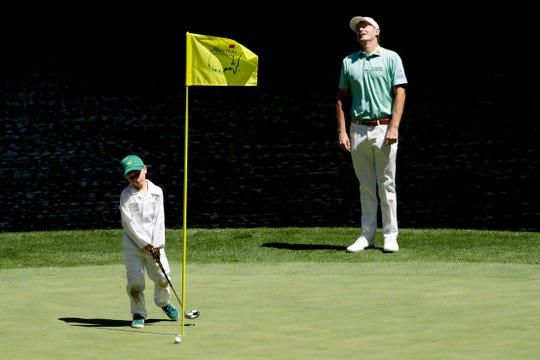 Brandt Snedeker reacts after his son, Austin, 6, missed a putt on the ninth hole during the par-3 golf tournament at the Masters Wednesday, April 10, 2019, in Augusta, Ga.