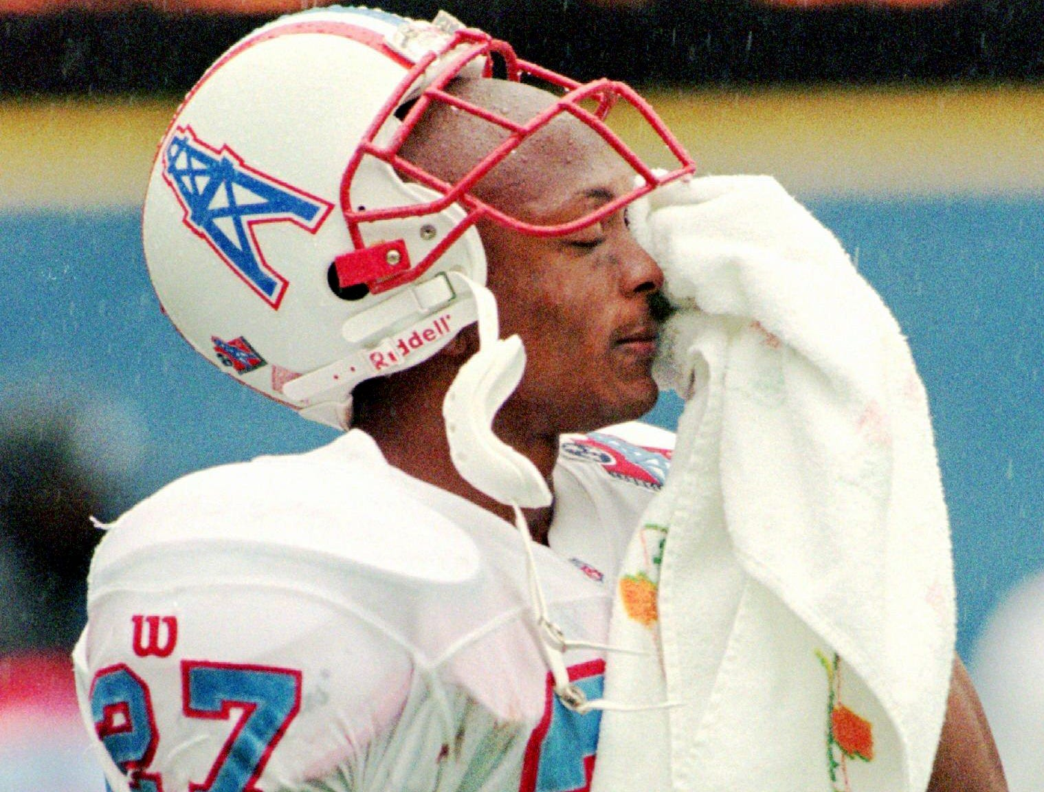 Tennessee Oilers running back Eddie George wipes his face in the closing moments of their 37-24 loss to the Pittsburgh Steelers in Pittsburgh Sept. 28, 1997.