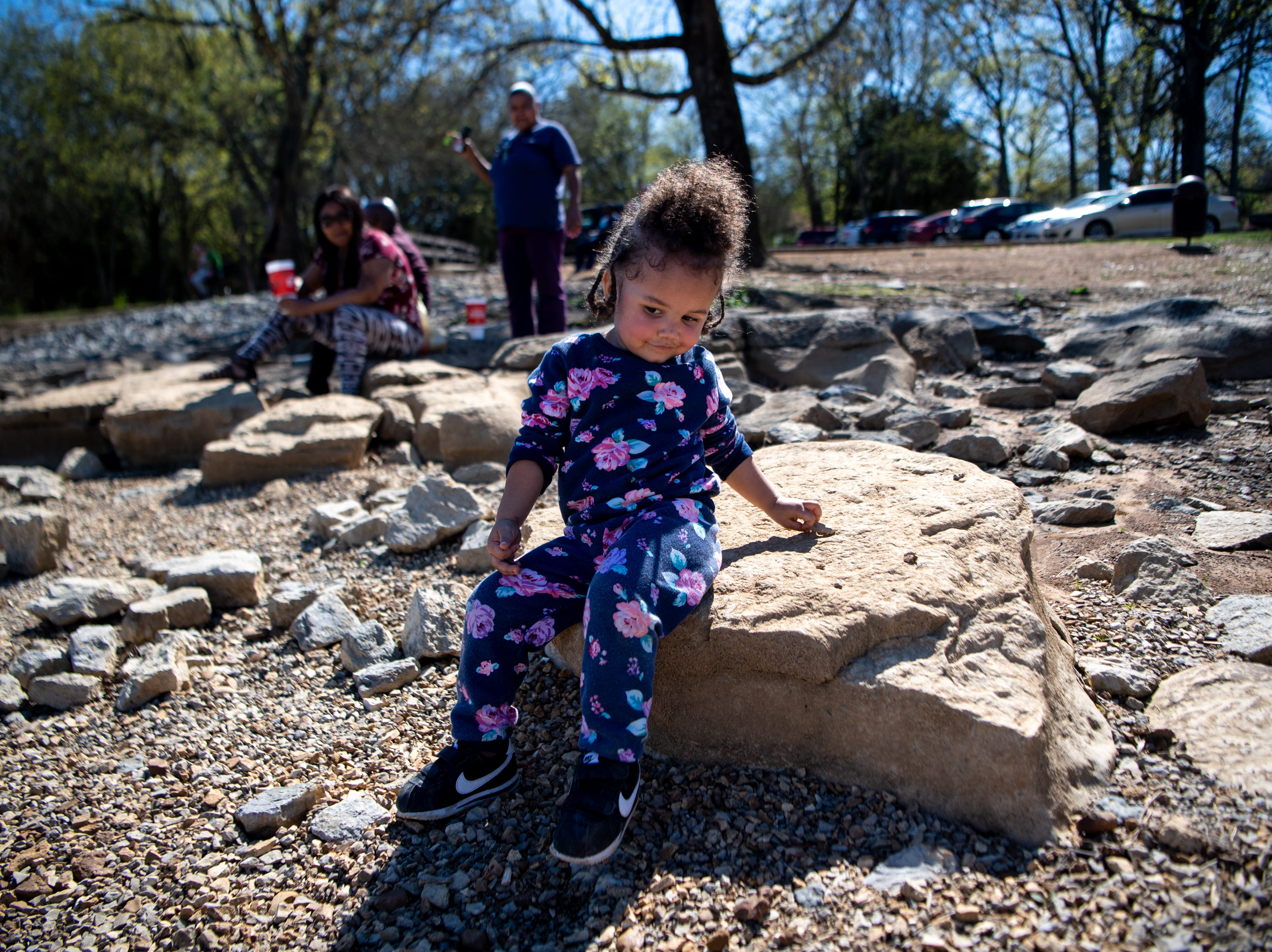 Diamond Covington, 2, plays with rocks at Percy Priest Lake Wednesday, April 10, 2019, in Nashville, Tenn.