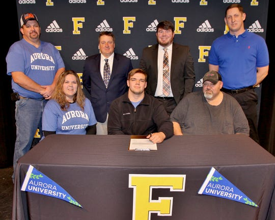 Fairview High's State wrestling champion and offensive left tackle, Jackson Clevenger, signed with Aurora University.
