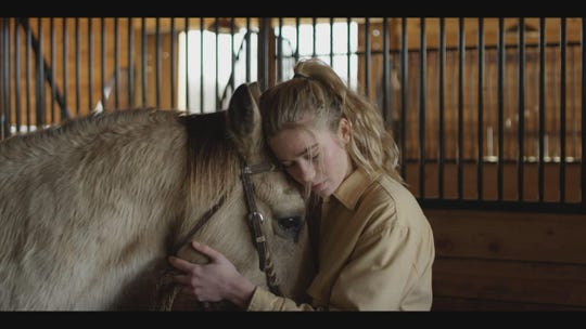 "Rose Reid's character hugs a horse in ""The World We Make,"" which was shot in Williamson County."
