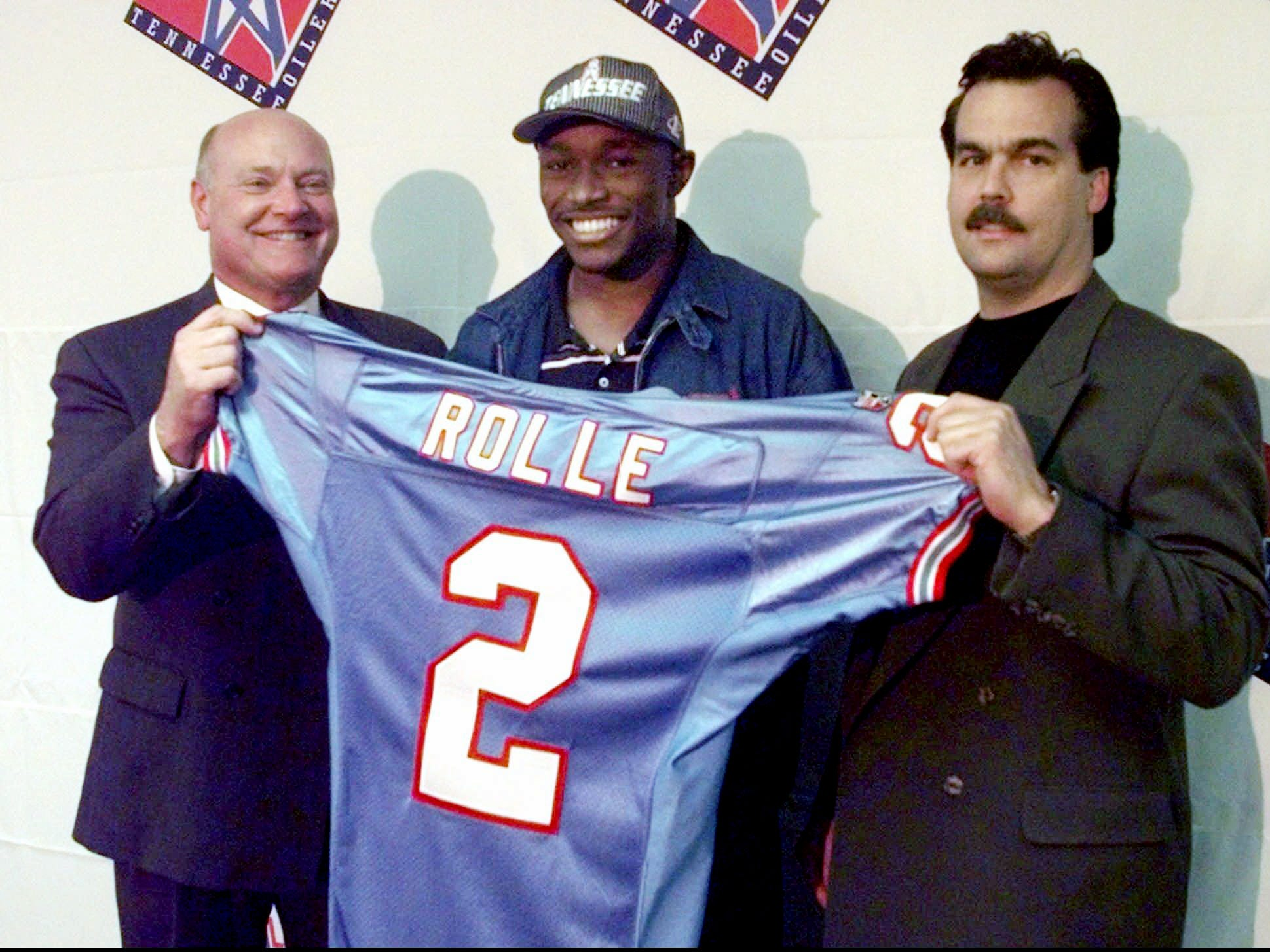 Samari Rolle, the second-round draft pick of the Tennessee Oilers, appears with general manager Floyd Reese, left, and coach Jeff Fisher, right, at the Oilers' offices in Nashville April 19, 1998. Rolle is a cornerback from Florida State.