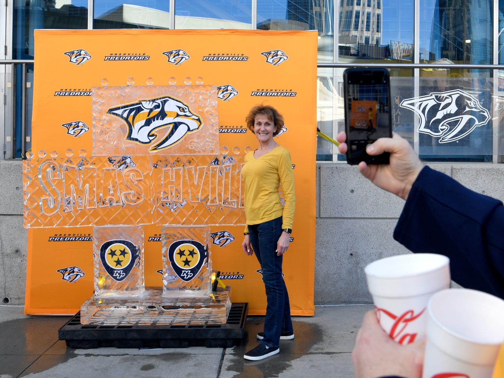 Emily Cochran of Nashville poses for a photo taken by her husband, Alan, at the melting ice sculpture before the divisional semifinal game at Bridgestone Arena in Nashville, Tenn., Wednesday, April 10, 2019.