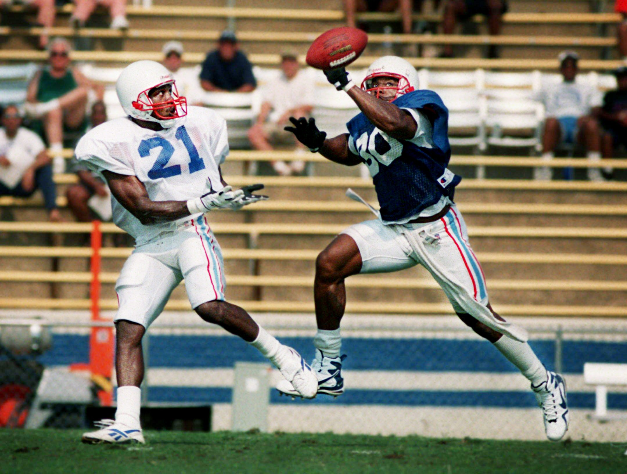 Tennessee Oilers defensive back Anthony Dorrset (30) almost gets a hand on a pass intended for running back Mel Gray (21) during their morning practice at Tennessee State University July 20, 1997.