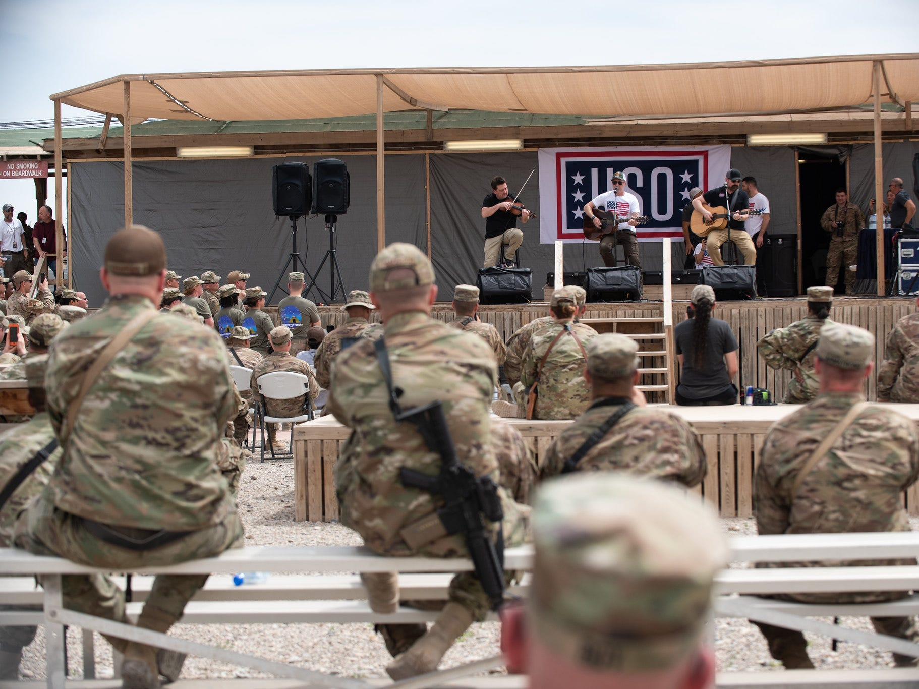 Entertainers and athletes take questions and interact with the audience during a USO Show at Kandahar Airfield, Afghanistan; the third stop on the annual Vice Chairman's USO Tour, April 1, 2019. Country music artist Craig Morgan, celebrity chef Robert Irvine, UFC Hall of Famer BJ Penn, former UFC Middleweight champion Chris Weidman, professional mixed martial artist Felice Herrig, two-time MLB World Series champion Shane Victorino; and professional surfer Makua Rothman joined Air Force Gen. Paul J. Selva, vice chairman of the Joint Chiefs of Staff, on a tour across the world.