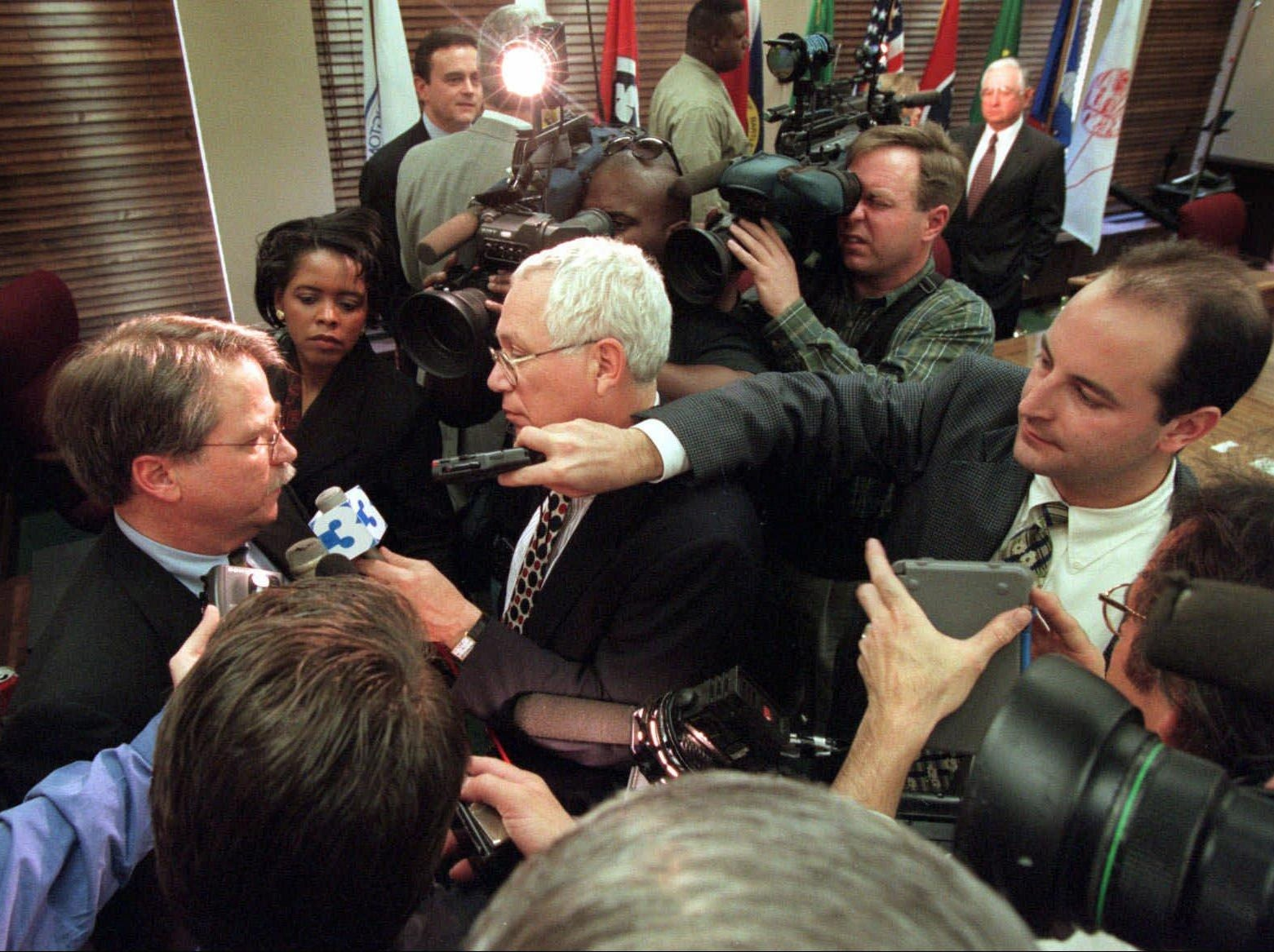 Steve Underwood, left, an attorney representing the Tennessee Oilers, speaks to reporters following a meeting of the Memphis and Shelby County Sports Authority Feb. 24, 1998 in Memphis, where an agreement was announced releasing the team from playing at the Liberty Bowl next season.