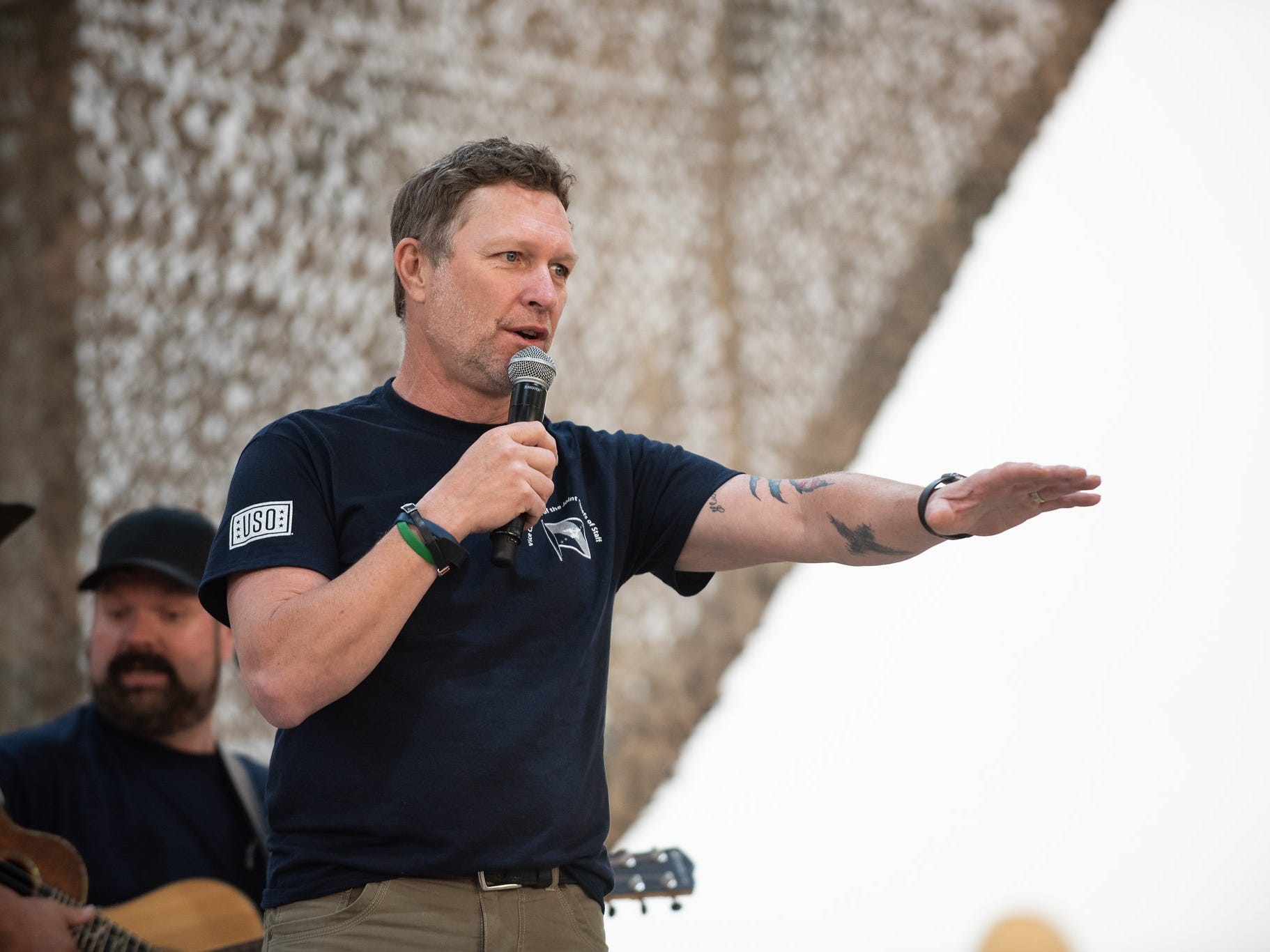 Craig Morgan interact with the audience during a USO Show at Al Asad Airbase, Iraq on April 2.