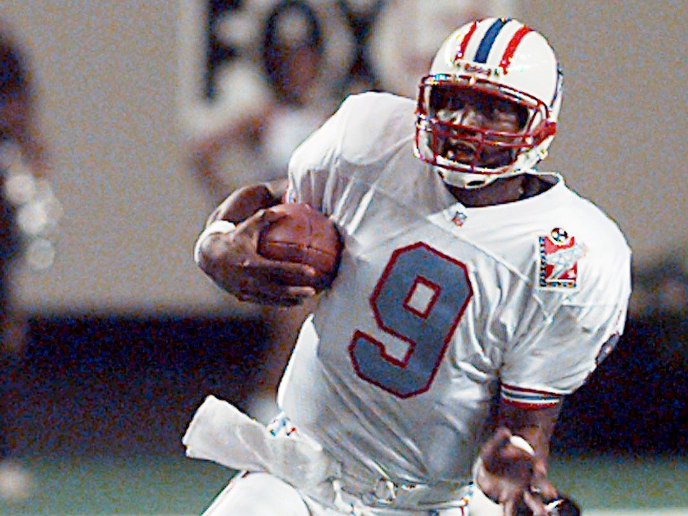 Tennessee Oiler quarterback Steve McNair (9) tucks the ball and runs during their game against the Atlanta Falcons Aug. 7, 1998 in a preseason game.