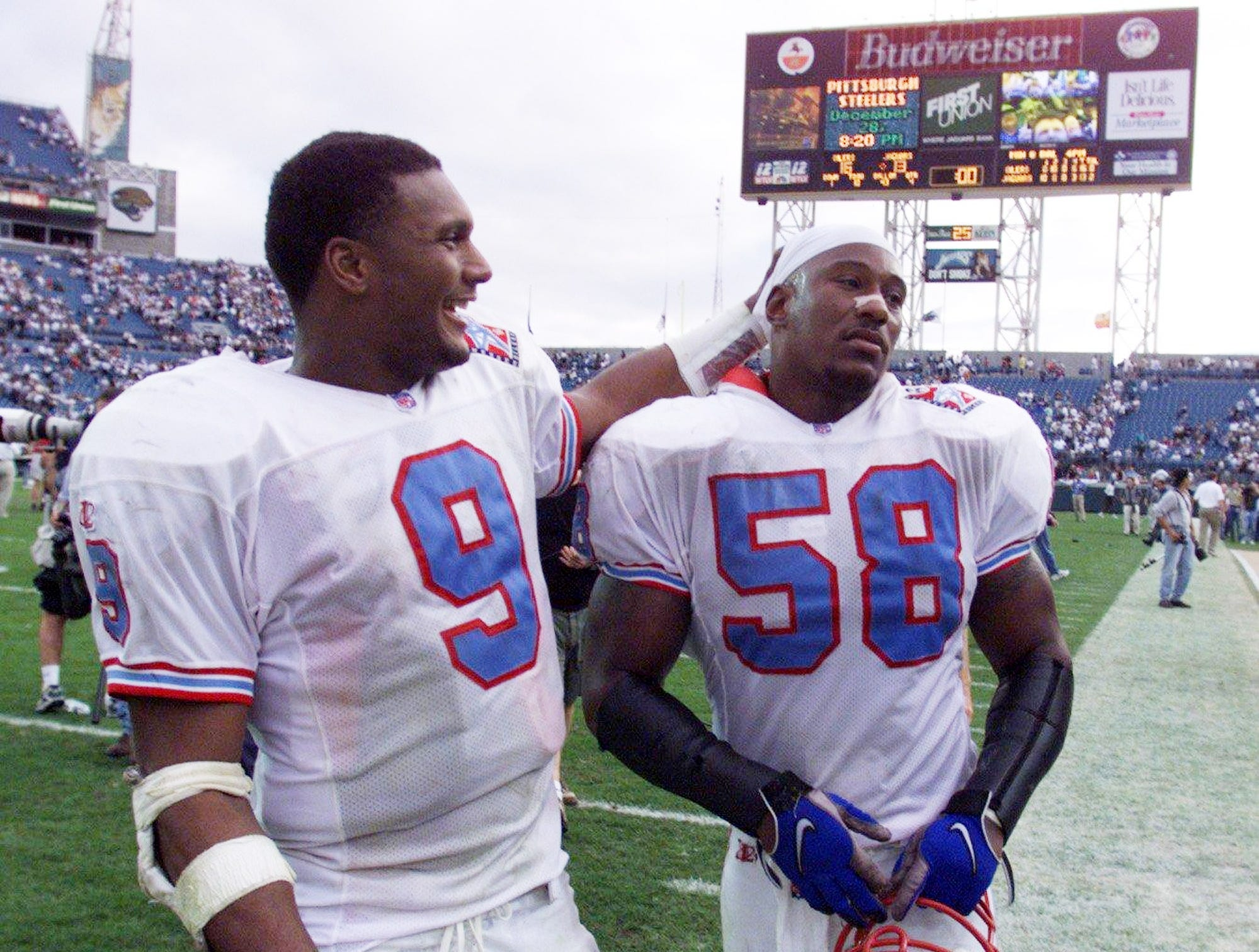 Tennessee Oilers quarterback Steve McNair (9) pats linebacker Joe Bowden on the head after they beating the Jaguars 16 to 13 in Jacksonville Dec. 13, 1998.