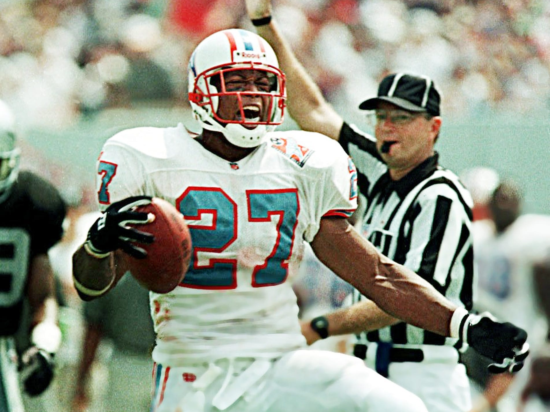 Running back Eddie George yells after a run that put the Tennessee Oilers near the goal line in the opening day game against the Oakland Raiders Aug. 31, 1997 in Memphis, Tenn.