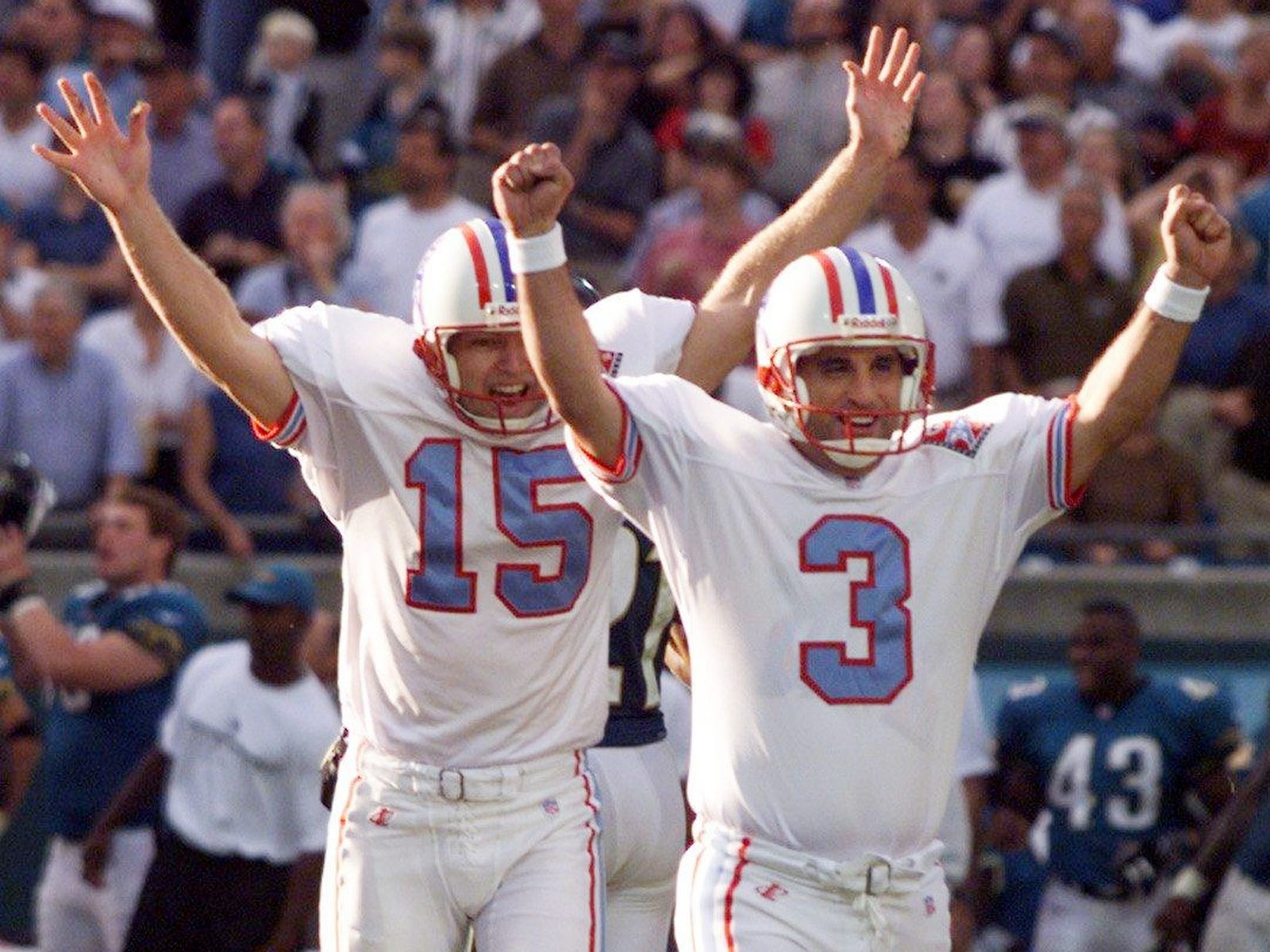 Tennessee Oilers kicker Al Del Grecco (3) and holder Craig Hentrich celebrate Dec. 13, 1998 after Del Grecco kicked the winning field goal for a 16-13 road victory against the Jacksonville Jaguars.