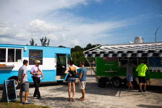 People attending the Naples City Live event can order food from a dozen local food trucks in Naples on April 6, 2019.