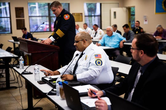 Eloy Ricardo, center, at  at a fire commissioner meeting held at North Collier Fire Control and Rescue District on April 10, 2019. Ricardo will soon be sworn in as the new chief at the facility.