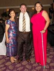 Mirian Gallardo, right, with her mother and PLAN Board Chair Dr. Bill Kuzbyt.