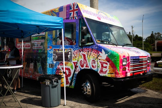 Dave's Cosmic Subs food truck serves customers at the Naples City Live event in Naples on April 6, 2019. The event featured a dozen local food trucks, a market that has grown exponentially in recent years.