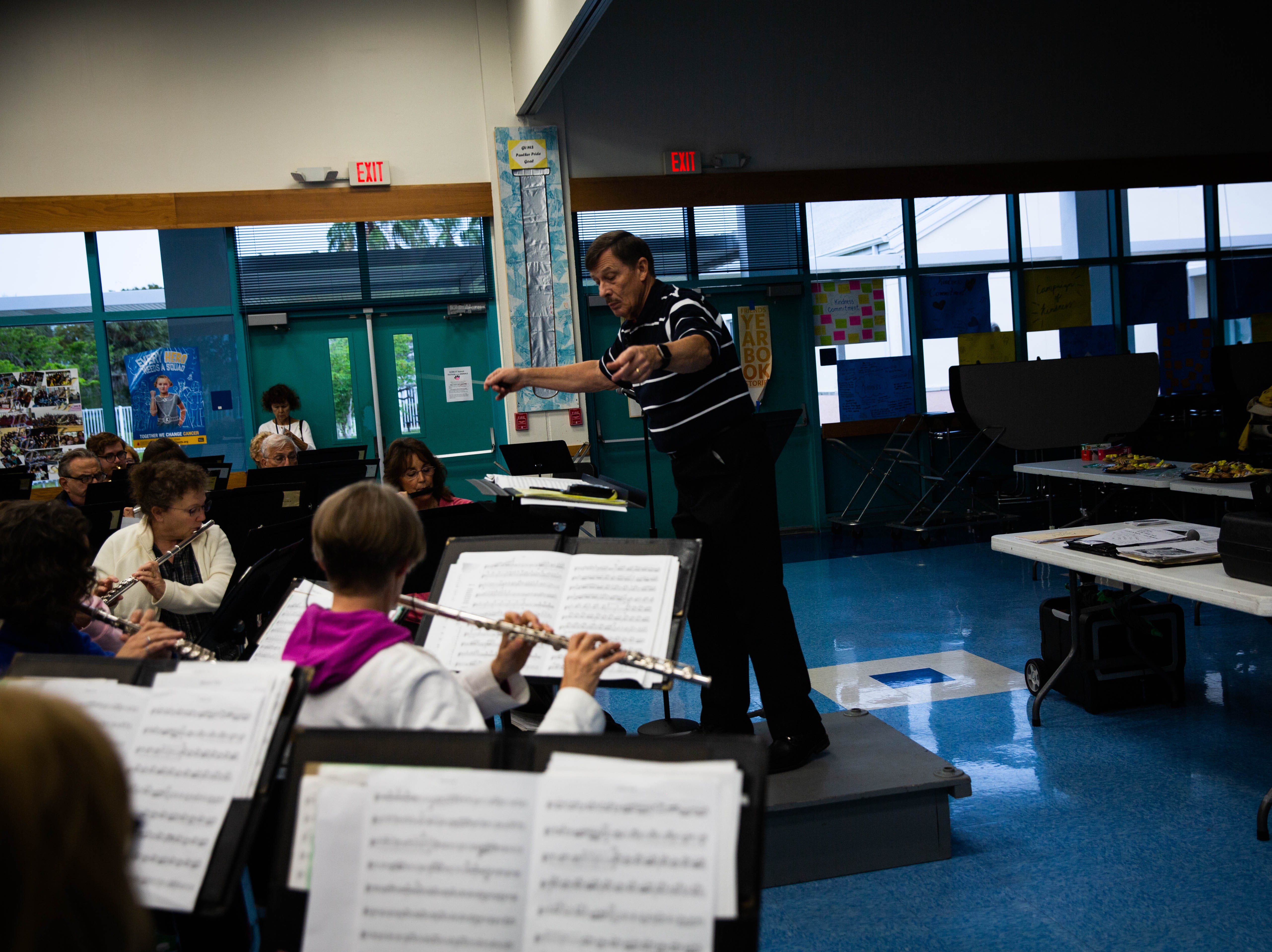Conductor Harris Lanzel leads the Naples Concert Band practice at Gulfview Middle School on April 9, 2019.