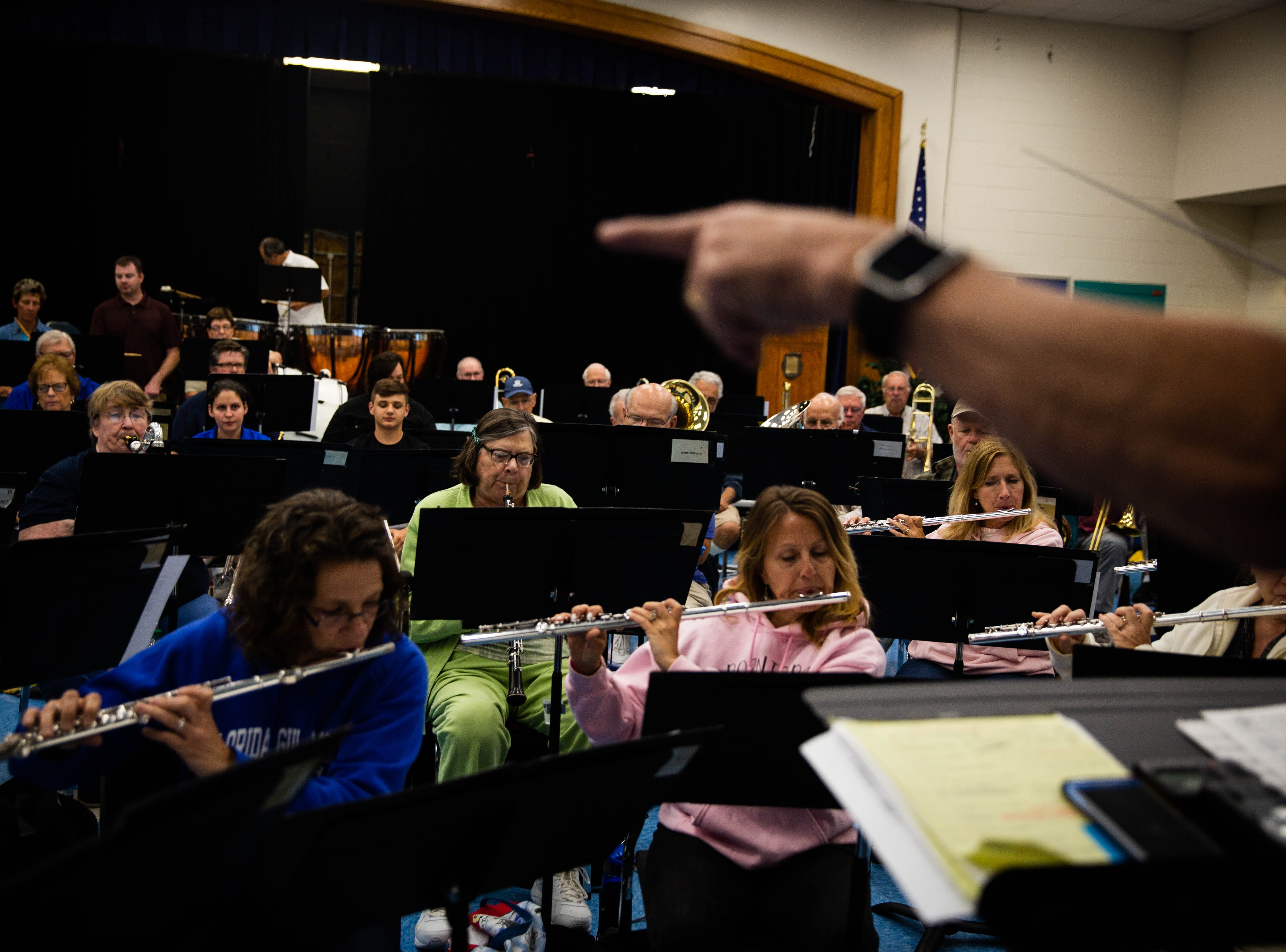 Conductor Harris Lanzel leads the Naples Concert Band practice at Gulfview Middle School on April 9, 2019. This was the last practice they will have at the school, where they have been practicing for 40 years.
