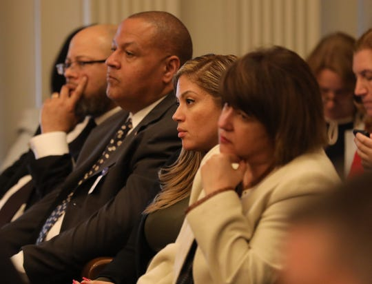 New hires by Schools Development Authority CEO Lizette Delgado-Polanco, left to right, Hashim Shomari, Cory LeDet, Laury-Ann Diaz and S. Patricia Cabrera. Diaz is the mother of Lizette Delgado-Polanco's grandchild. They are seen at a hearing in Trenton in April 2019.