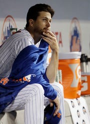 New York Mets starting pitcher Jacob deGrom, last year's National League Cy Young award winner, sits in the dugout after allowing six runs during the firsts four innings of an interleague baseball game against the Minnesota Twins, Tuesday, April 9, 2019, in New York.