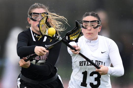 River Dell and Wayne Hills girls lacrosse played on Tuesday, April 9, 2019 in Oradell. Kaitlyn Davies #16 and Jayne Manzelli #13.