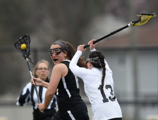 River Dell and Wayne Hills girls lacrosse played on Tuesday, April 9, 2019 in Oradell. Lexi Segil #10 and Jayne Manzelli #13.