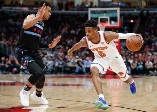 New York Knicks guard Dennis Smith Jr. (5) drives to the basket against Chicago Bulls guard Timothe Luwawu-Cabarrot during the first half of an NBA basketball game Tuesday, April 9, 2019, in Chicago.