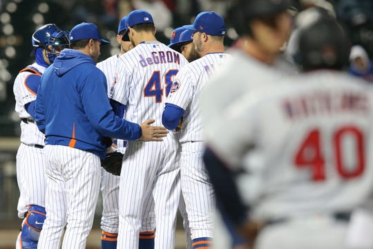 Apr 9, 2019; New York City, NY, USA; New York Mets manager Mickey Callaway (second from left) talks to starting pitcher Jacob deGrom (48) during the fourth inning against the Minnesota Twins at Citi Field.