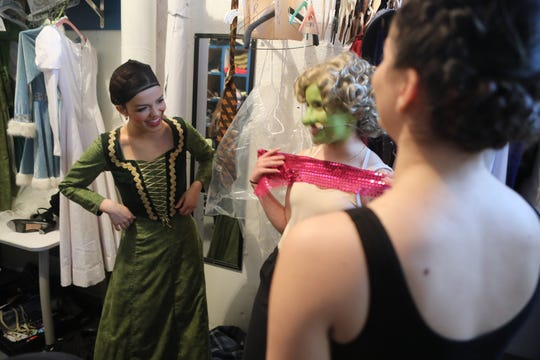 """Clifton's Rachel Zegler, left, laughs with castmates before a dress rehearsal for """"Shrek: The Musical,"""" which has sold out its weekend run at Immaculate Conception High School in Lodi. Zegler has been cast as Maria in Steven Spielberg's film adaptation of """"West Side Story,"""" which is slated to film this summer."""