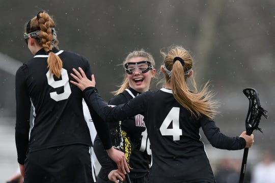 River Dell and Wayne Hills girls lacrosse played on Tuesday, April 9, 2019 in Oradell. Wayne Hills' teammates Kaitlyn Davies #16 and Kate Lo Presti #4 celebrate a goal by Ella Harris #9.