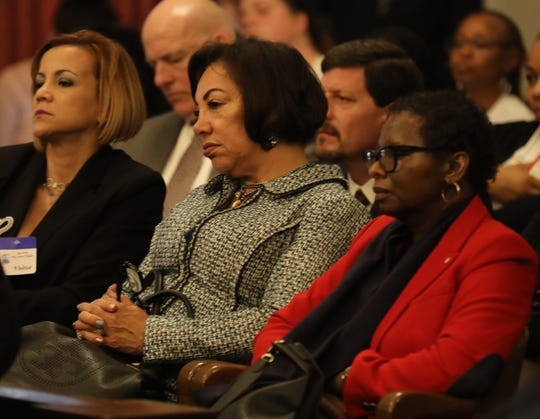 From left to right, schools authority employees Raquel Seguinot, deputy chief of staff Patricia Arcila Cabrera and vice president Pamela Luster in the gallery as  CEO Lizette Delgado-Polanco testifies about her department in front of the Assembly Budget Committee.