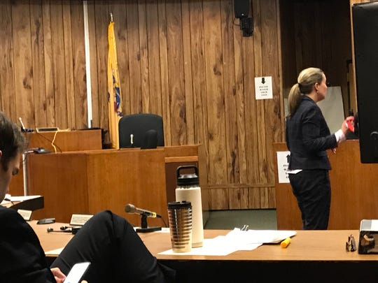 Assistant Prosecutor Jennifer Fetterman showing the jury the .380 handgun used in the shooting of Tishell Jackson. April 10, 2019