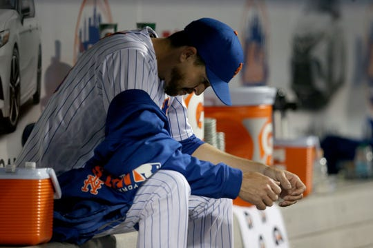 Apr 9, 2019; New York City, NY, USA; New York Mets starting pitcher Jacob deGrom (48) reacts in the dugout during the fourth inning against the Minnesota Twins at Citi Field.