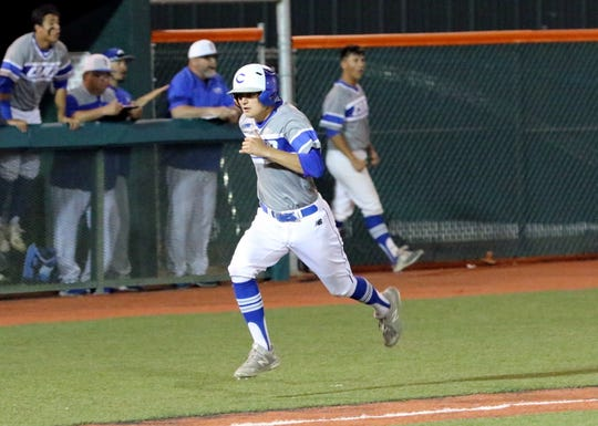 Carlsbad's Tate Collins runs home to cut Artesia's lead to 3-2 in the top of the seventh inning during Tuesday's game. Collins also scored the game-winning run in the ninth inning.