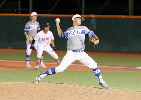 TJ Ruiz pitches during Tuesday's game against Artesia. Ruiz pitched the first seven innings for the Cavemen. Carlsbad won in nine innings, 4-3.