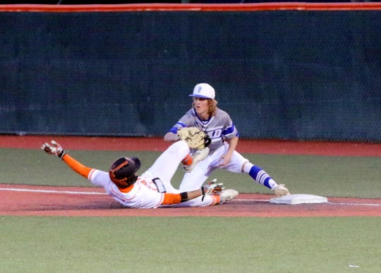 Carlsbad's Gaige Madron gets a force out against Artesia to complete one of the Cavemen's four double plays during the April 9 game against Artesia.