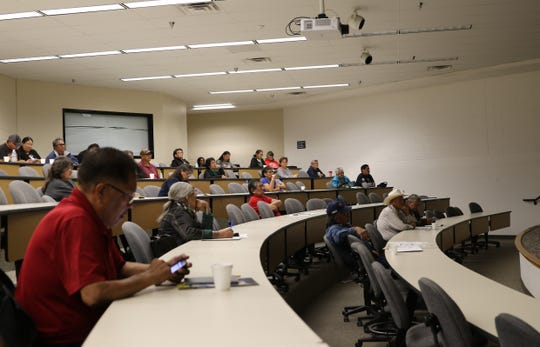Attendees learn about the Land Buy-Back Program under the U.S. Department of the Interior during an information session on Tuesday at San Juan College in Farmington.