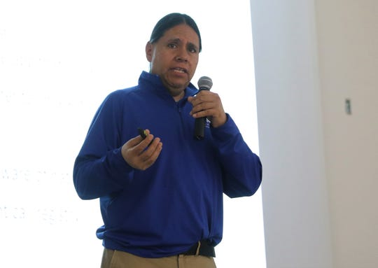 Shawn Spruce, a financial education consultant with First Nations Development Institute, talks about financial planning during an information session about the Land Buy-Back Program on Tuesday at San Juan College in Farmington.