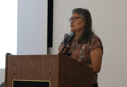 Virginia Moore, fiduciary trust officer for the Office of the Special Trustee for American Indians, talks about the office's role in the Land Buy-Back Program on Tuesday at San Juan College in Farmington.