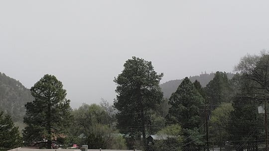 View of Highway 70 in Ruidoso. The dust being blown in from White Sand is thick in the air. Winds up to 75 mph have crated low visibility.