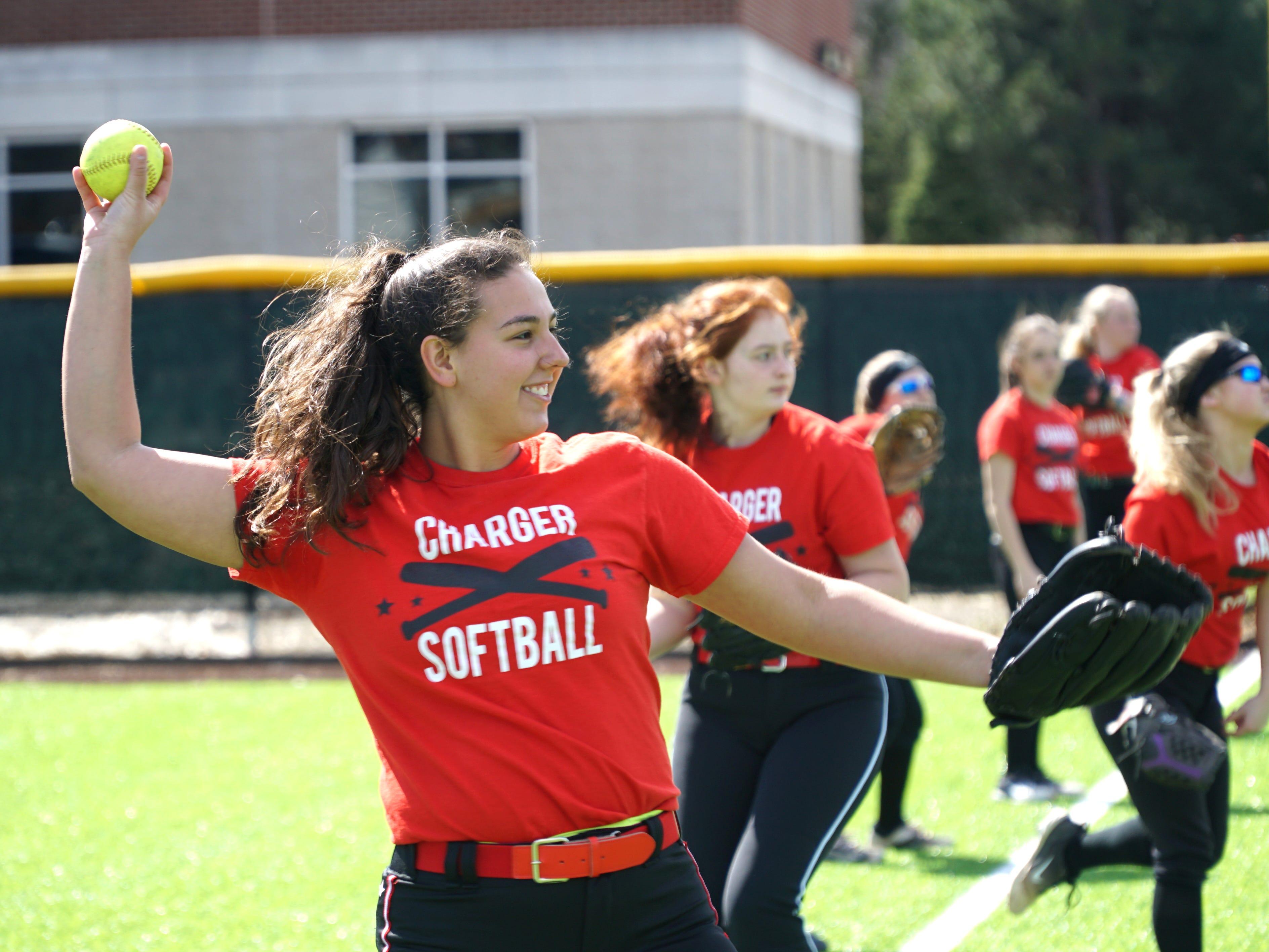 Churchill Charger softball senior and team captain Rachel Klisz warms up on April 9.