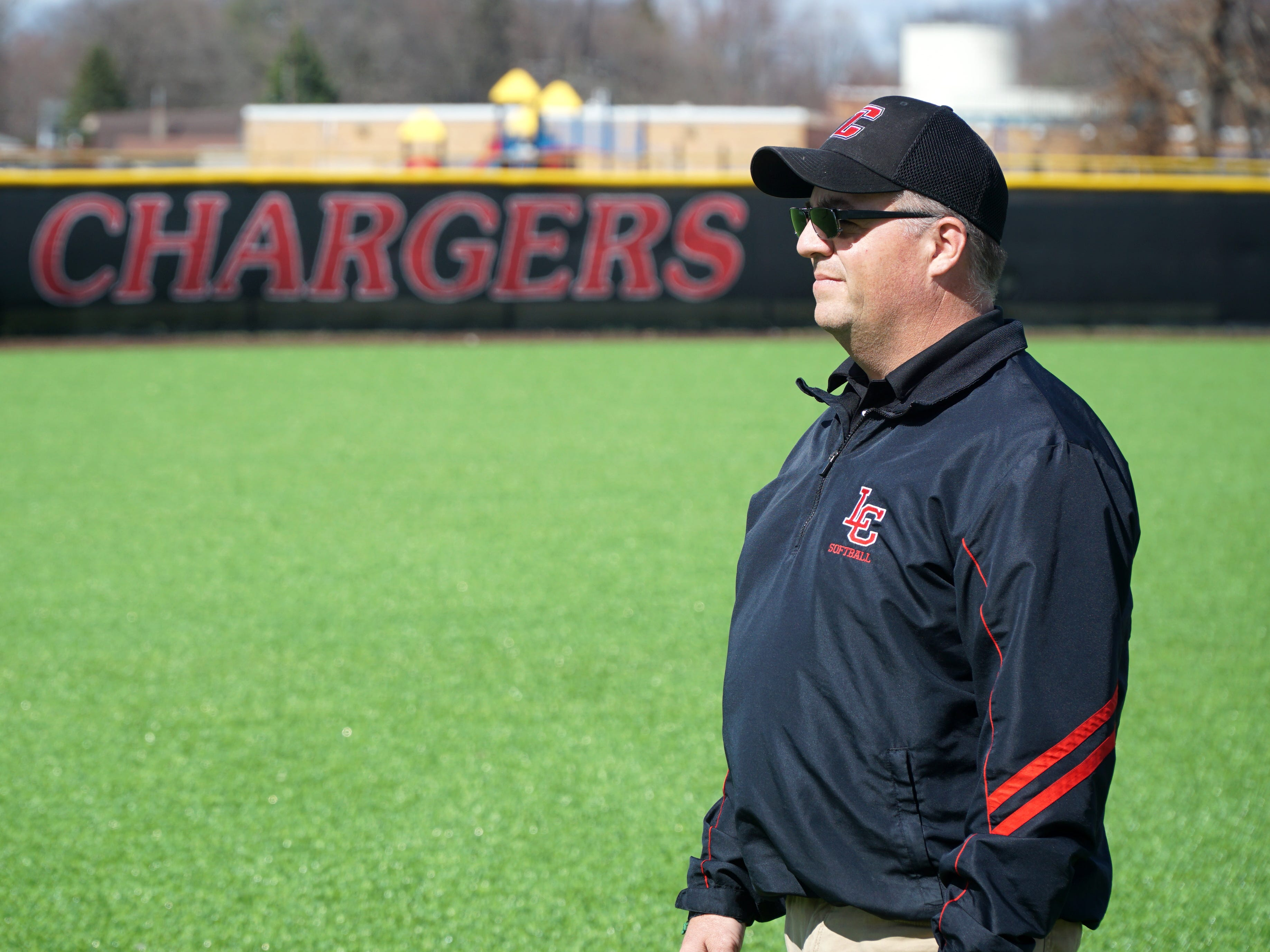 Churchill Charger softball coach Abe Vinitski watches his team practice on April 9, 2019.