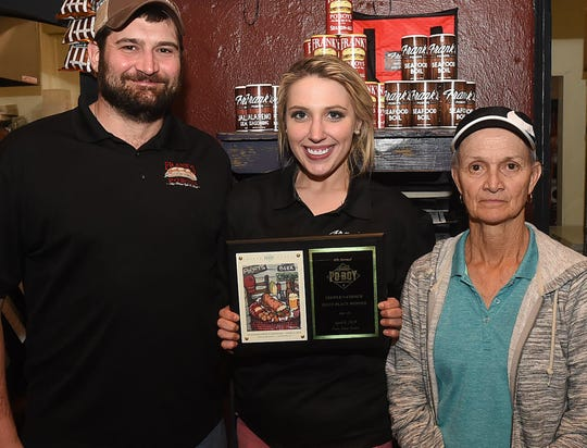 Frank's Po-Boys of Opelousas was the People's Choice winner at the annual Po_Boy Festival held Saturday, April 6, in Lafayette. From left are Michael Fontenot, Caroline Cosgrove and Sharon Fontenot, Frank's owners.