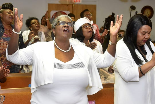 Mt. Pleasant Baptist Church parishoners sing praise as they attend Sunday services at Morning Star Baptist Church in Opelousas.